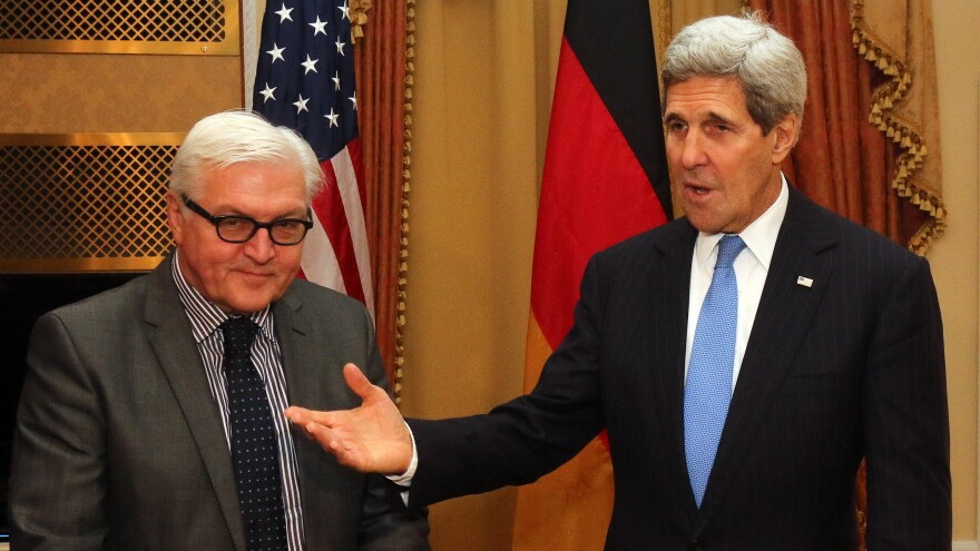 German Foreign Minister Frank-Walter Steinmeier, left, and Secretary of State John Kerry meet during closed-door nuclear talks with Iran in Vienna Saturday.