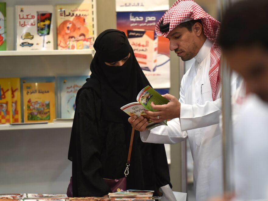 Saudi men and women browse the annual Riyadh International Book Exhibition in 2016.