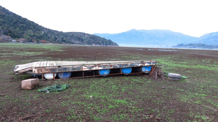A dock rests in a dry waterbed in central Chile.