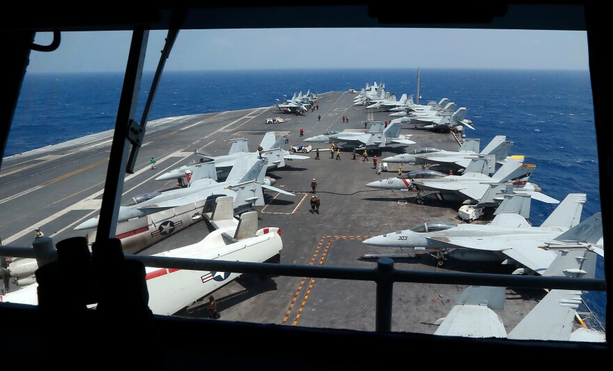 "Fighter jets onboard the U.S. Navy aircraft carrier USS Carl Vinson off the disputed South China Sea on March 3. The carrier was recently ordered to ""report on station in the Western Pacific Ocean,"" instead of sailing for Australia as planned."