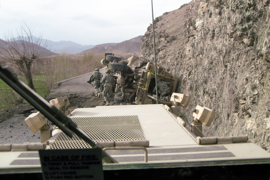 A mine-resistant, ambush-protected vehicle, or MRAP, that was leading a patrol in Afghanistan's Tangi Valley in 2009 was upended by a 500-pound homemade explosive. Minutes later, a rocket-propelled grenade hit the cliff wall above, initiating a firefight that pinned down Kit Parker and the rest of the platoon.