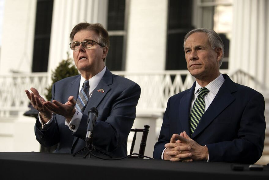 Lt. Gov. Dan Patrick, left, sits next to Gov. Greg Abbott as he speaks during a press conference at the Governor's Mansion on Wednesday.