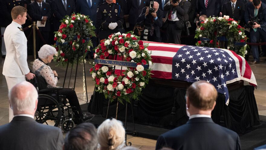 Roberta McCain, mother of John McCain, pays respects before his flag-draped casket Friday at the Capitol rotunda. His final public memorial was Saturday at the National Cathedral.