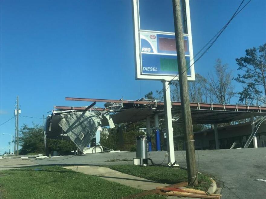 hurricane damage to a sign and building