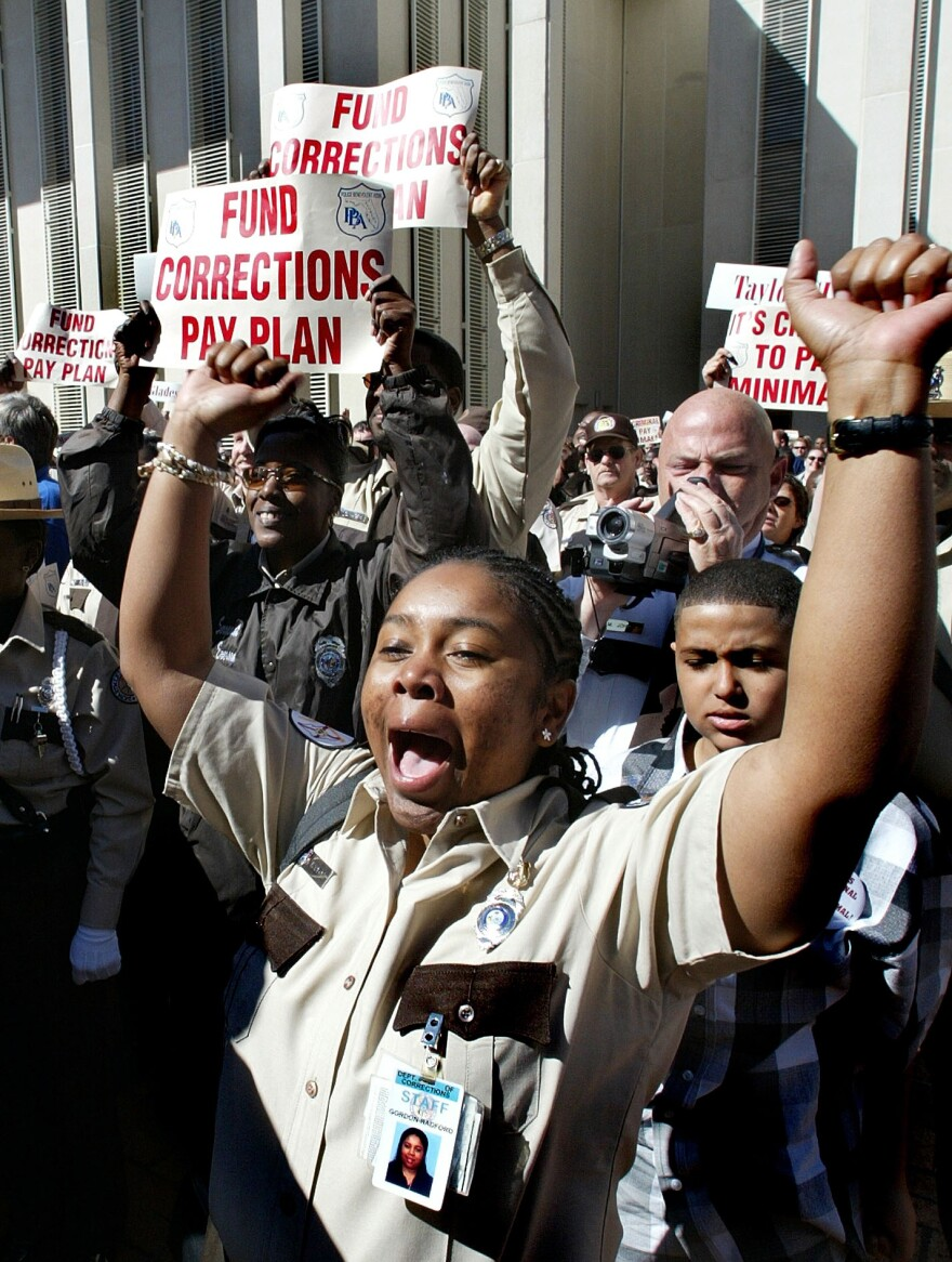 Department of Corrections officer Irasema Radford, from Miami, takes part in a correctional officers rally organized by the Florida Police Benevolent Association, Monday, March 8, 2004, in Tallahassee, Fla. The officers rallied in support of higher pay