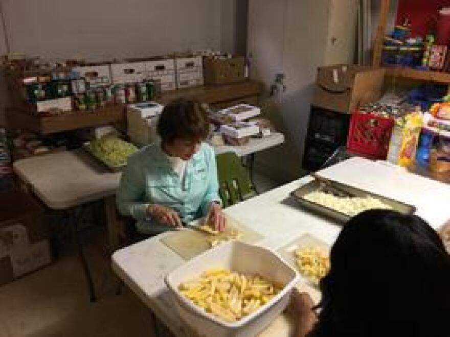 Graham cutting potatoes.