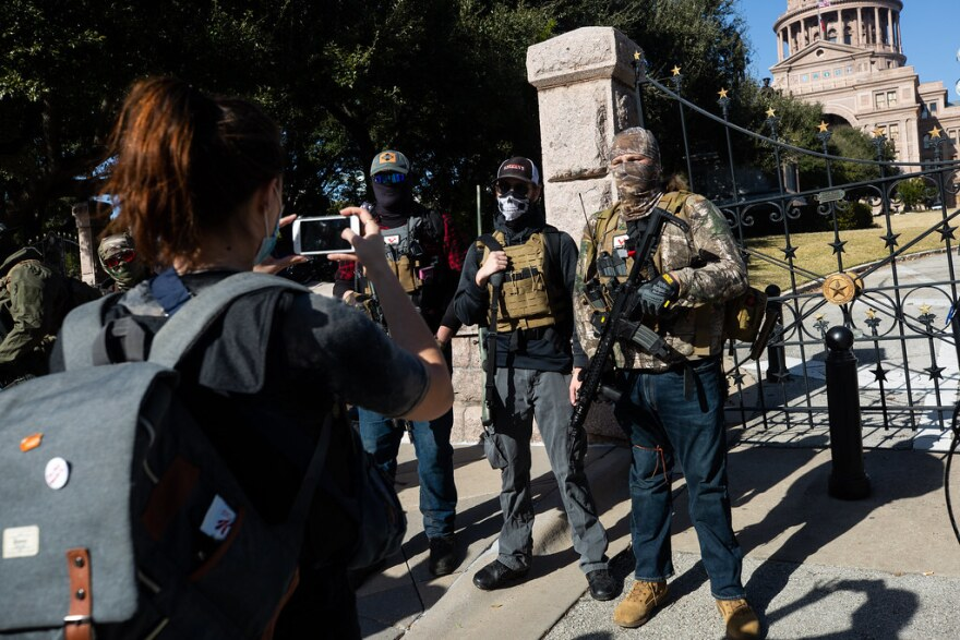 A small group of armed protesters rally outside of the Texas state Capitol grounds. Protesters separated themselves from individuals who took part in the recent attack at the U.S. Capitol, saying their demonstration was scheduled months before.