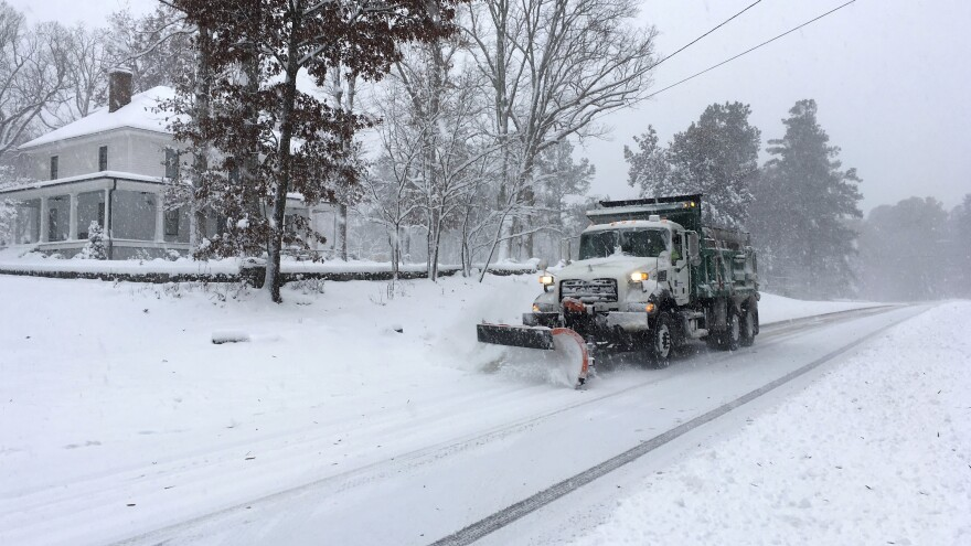"A snow plow moves on a snowy Durham, N.C., street on Sunday. Weather Prediction Center forecaster David Roth told NPR this could be a ""historic storm"" for southwest Virginia and western North Carolina."
