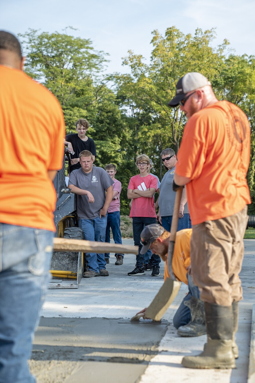 Edwardsville High School juniors watch labor apprentices level off concrete on Sept. 10. The students will have an opportunity to pour concrete as they progress through their two year program.