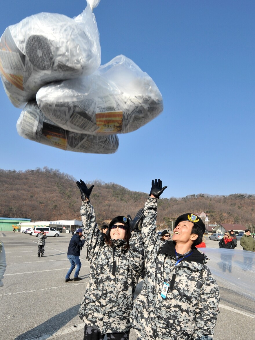 Former North Korean defectors release a balloon carrying anti-North Korea leaflets in the border town of Paju, north of Seoul, in January 2014. Activists launch thousands of anti-Pyongyang leaflets and Wikipedia-loaded USB keys across the border.