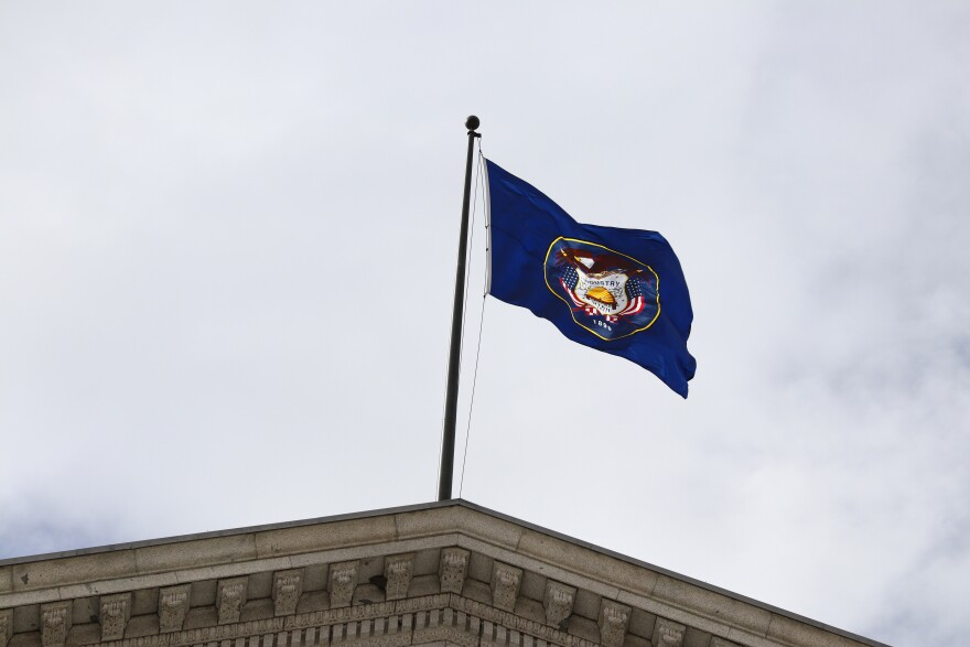 Photo of Utah flag on Capitol building.