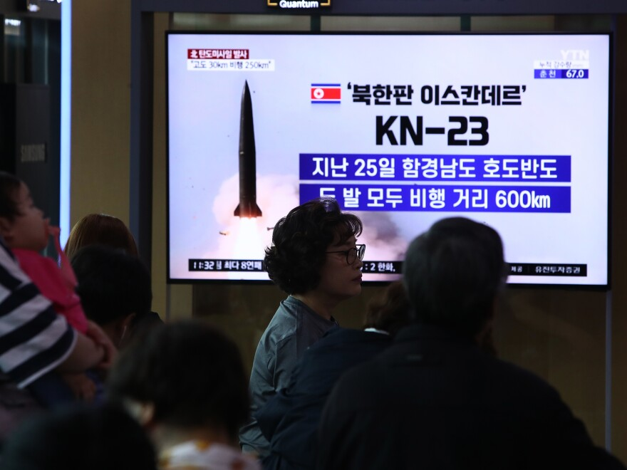 South Koreans in Seoul on Wednesday watch a news report about a missile launch.