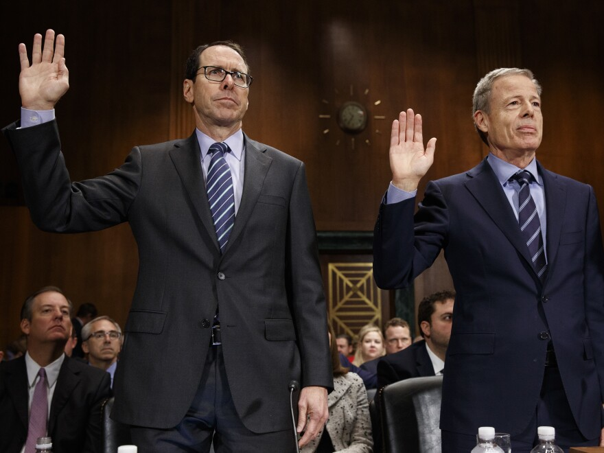 AT&T CEO Randall Stephenson (left) and Time Warner CEO Jeff Bewkes are sworn in Wednesday before testifying at a Senate committee hearing on the proposed merger of their companies.