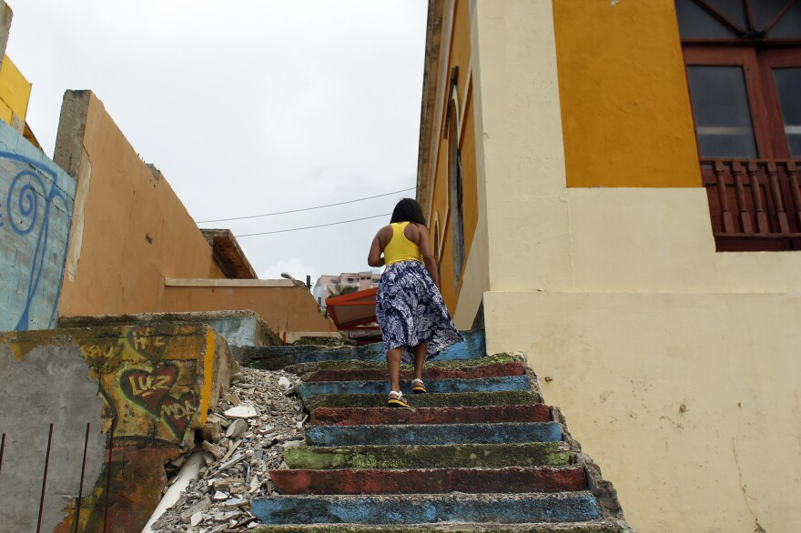 A woman walks through La Perla, a neighborhood on the edge of Old San Juan, in 2017.