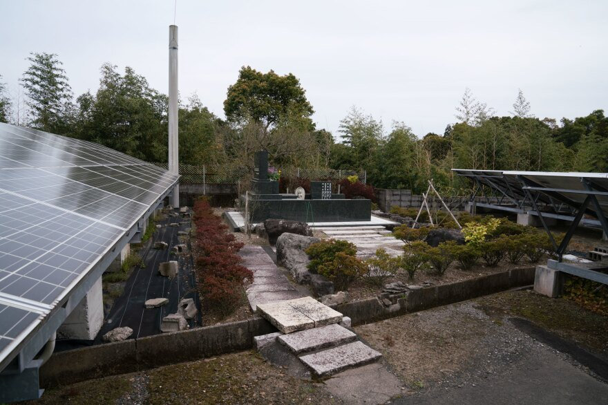 Hiroyuki Endo's grave sits in the middle of the solar farm he and his family built after fleeing Fukushima.