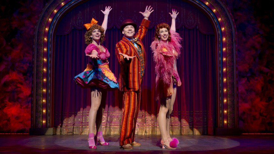 """<strong></strong>Danny Burstein, as Buddy Plummer, performs """"Buddy's Blues,"""" the high-energy song-and-dance number at the end of <em>Follies, </em>with Jenifer Foote (left) and Kiira Schmidt.<em></em>"""