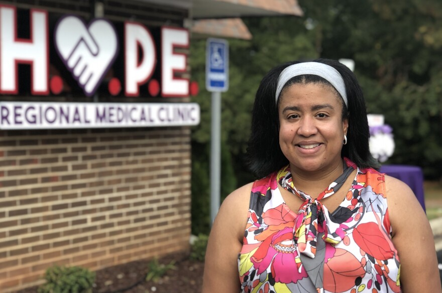 Dr. Demaura Russell stands in front of Hope Regional Medical Clinic in Warrenton, NC. She started seeing patients in September 2019.
