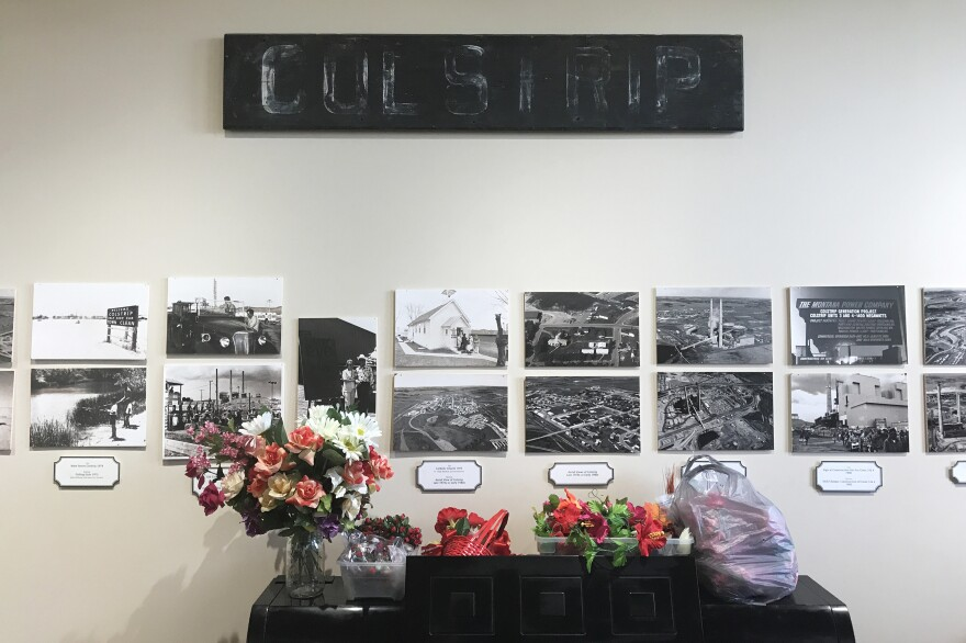 """Colstrip's history is laid out in old photos that line the walls of the town's historical center. """"That's who we are,"""" says Lu Shomate, the center's director. """"If it wasn't for the coal and then the generation [of electricity], of course, none of this would be here."""""""