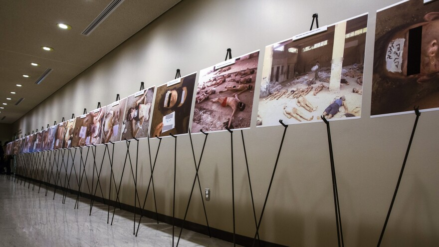 Images of dead bodies in Syrian prisons, taken by a Syrian government photographer, are displayed at the United Nations on March 10. The photographer, who goes by the pseudonym Caesar, took the pictures between 2011, when the Syrian uprising began, and 2013, when he fled the country. His photos will be on display at the U.S. Capitol on Wednesday.