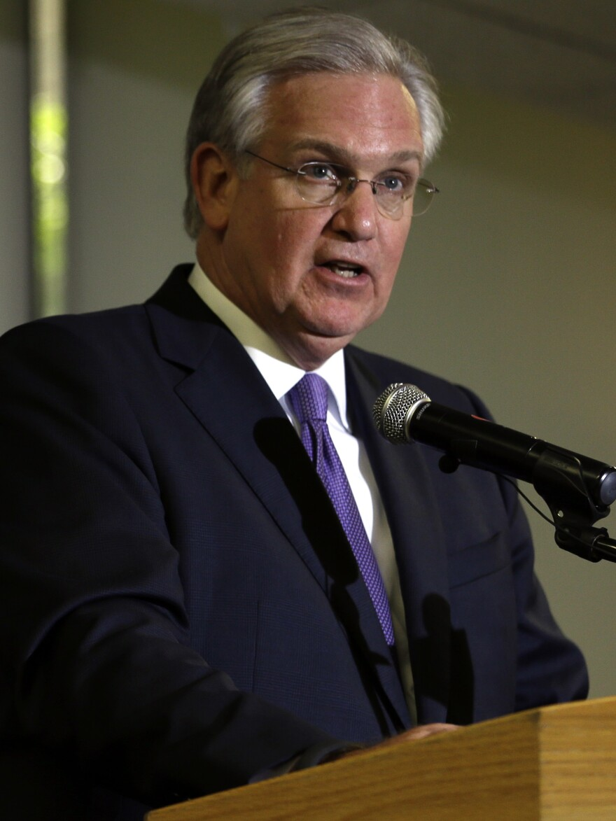 Missouri Gov. Jay Nixon speaks during a news conference in St. Louis. Nixon ordered the Missouri State Highway Patrol to take over the supervision of security in Ferguson.