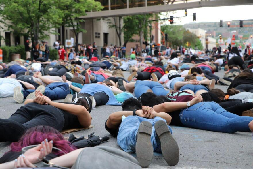 Hundreds of people lie on N 27th St. and Second Ave. N in protest of police brutality at the Justice for George Floyd & Black, Indigenous and People of Color In Our Community/World in Billings June 7, 2020.