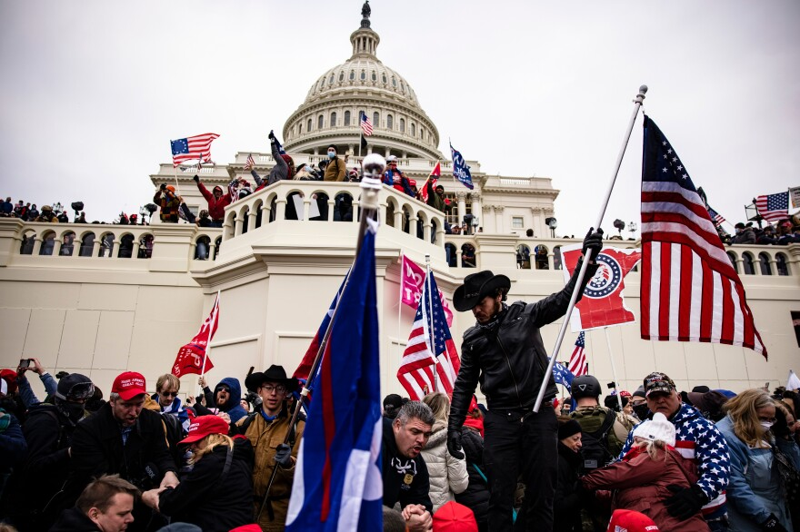 Pro-Trump extremists storm the U.S. Capitol following a rally with President Trump on Wednesday.