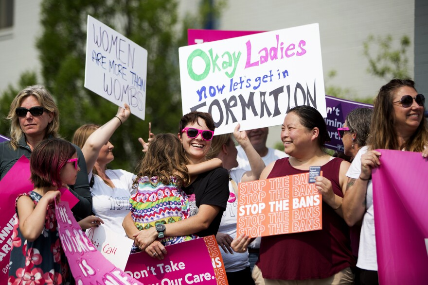 Supporters rally outside Planned Parenthood on Forest Park Ave. on Friday after a St. Louis Circuit Court judge issued a temporary restraining order that keeps the clinic's license valid.