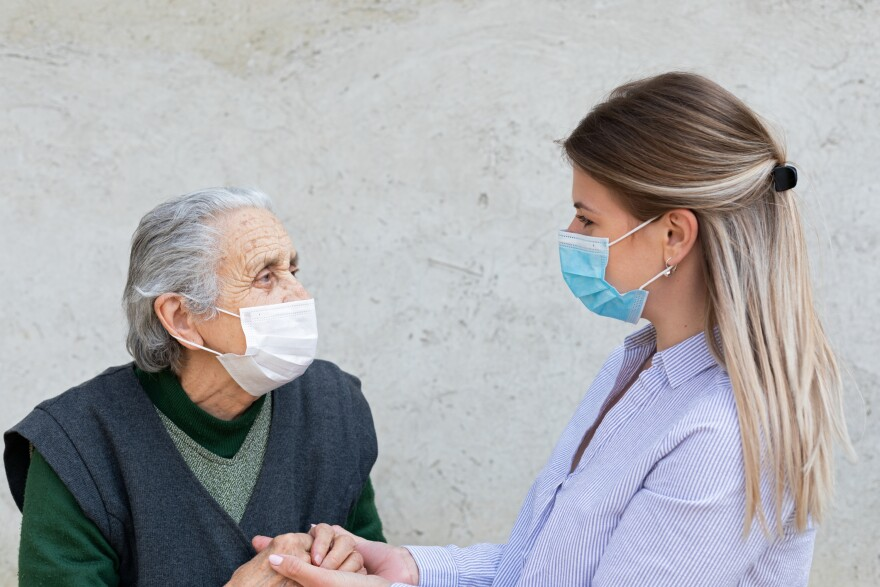 a photo of a patient with a caregiver
