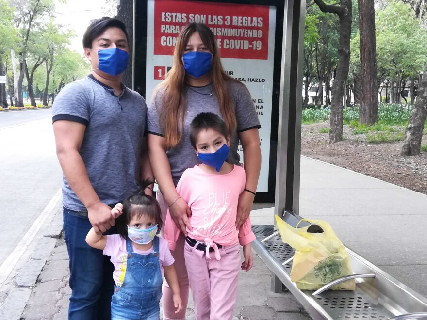 In Mexico, even children have to wear masks. The Rojas Family at a bus stop in Mexico City.
