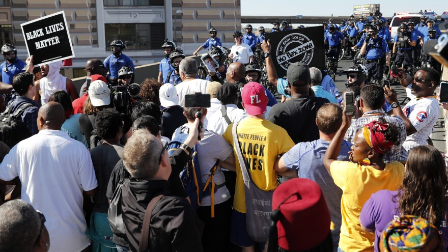 Protesters gather outside the courthouse in downtown St. Louis on Friday, after a judge found a white former St. Louis police officer, Jason Stockley, not guilty of first-degree murder in the death of a black man, Anthony Lamar Smith, who was shot after a high-speed chase in 2011.