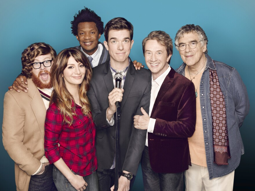 Comedian John Mulaney (center) stars with Zack Pearlman (from left), Nasim Pedrad, Seaton Smith, Martin Short and Elliott Gould on the Fox sitcom <em>Mulaney</em>.