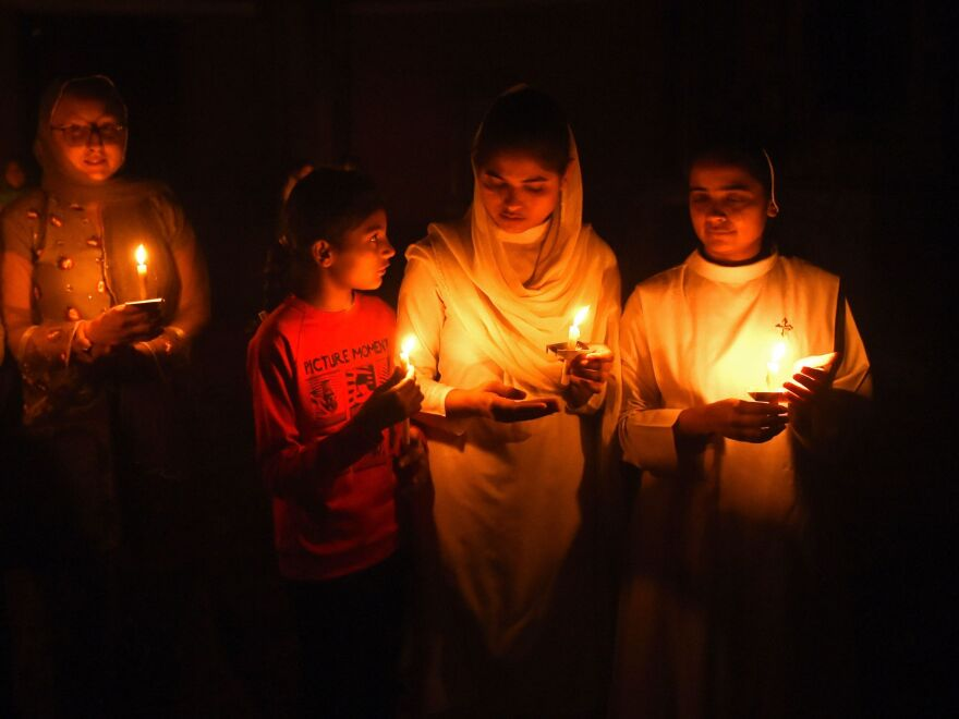 Pakistani Christians attend an Easter vigil mass at the Sacred Heart Church in Lahore.