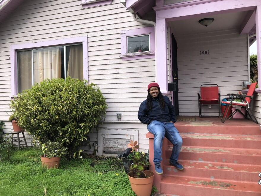 Marquita Price outside her grandmother's house in East Oakland. She worries that contaminated rising groundwater threatens the health of her family and their assets.