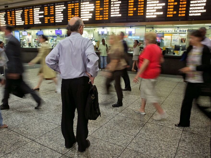 A man checks the Long Island departure board at New York's Penn Station on Tuesday