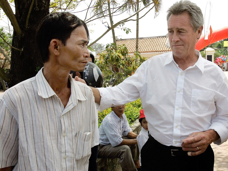 My Lai Massacre survivor Do Ba, 48, left, of Ho Chi Minh City, meets with former U.S. Army officer Lawrence Colburn, 58, right, of Canton, Ga., on the 40th anniversary of the massacre. Colburn and his fellow helicopter crew members rescued Do Ba during the massacre.
