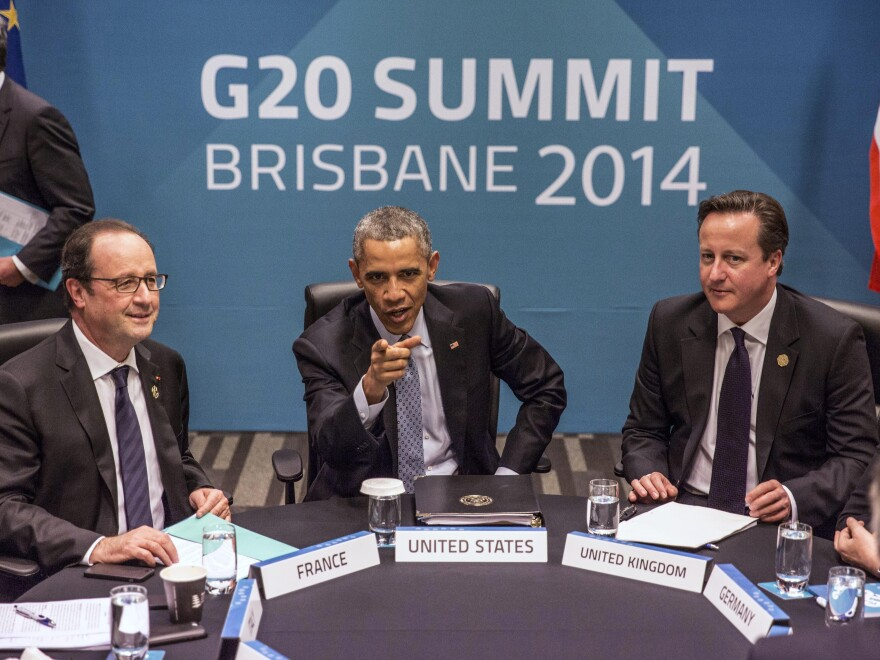French President Francois Hollande (from left), President Obama and British Prime Minister David Cameron at the G-20 summit in Brisbane, Australia, in November 2014.