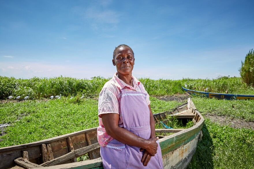 Alice Amonde sits on a boat on the village of Nduru Beach, Kenya. She is part of the group of women who have fought against the practice of transactional sex that was part of the fishing business. This photograph was taken in November 2019. This spring, flooding from Lake Victoria devastated the village.