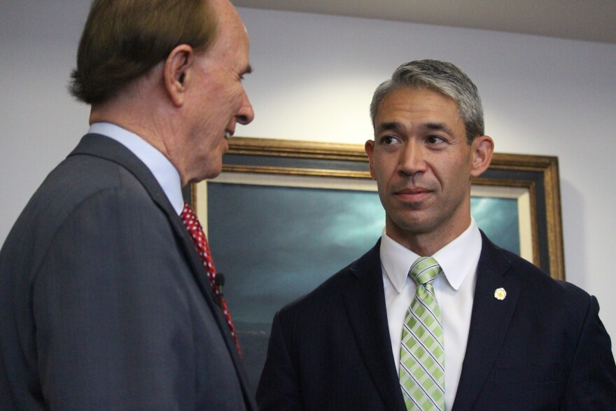 Bexar County Judge Nelson Wolff and San Antonio Mayor Ron Nirenberg speak after a press conference on March 19.
