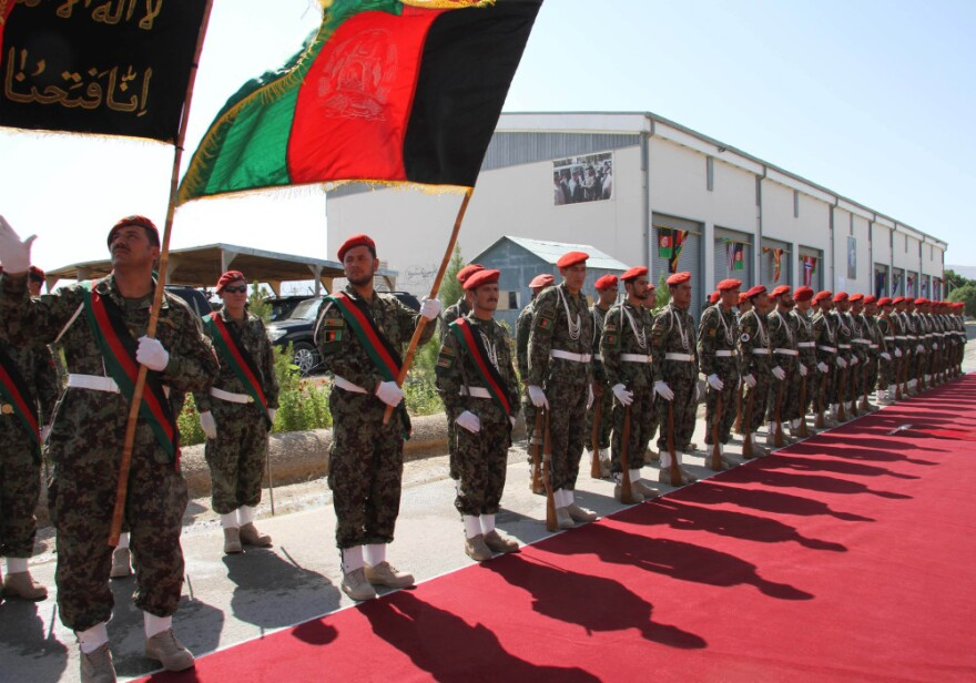 Afghan Army soldiers stand during a security transition ceremony in Mazar-e-Sharif, north of Kabul, Afghanistan, on July 23, 2011. The Afghan government officially took control of security in the capital of the peaceful northern province of Balkh on July 23, as part of an effort to begin handing over all security responsibilities to Afghan forces by 2014.