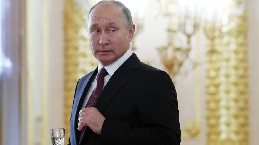 Russian President Vladimir Putin attends a ceremony to receive diplomatic credentials from newly appointed foreign ambassadors at the Kremlin in Moscow on Oct. 11.
