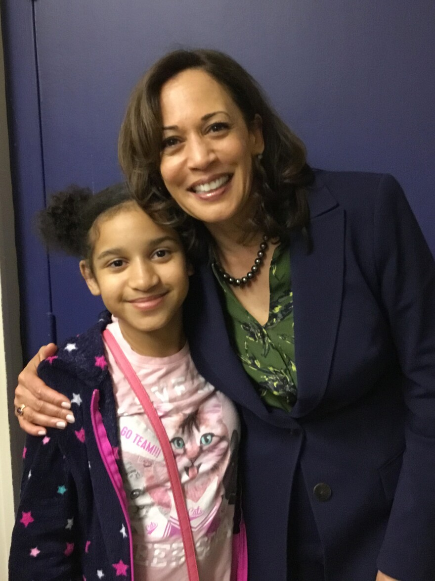 Harris poses with Jasmeen Coronado, then age 9, at a campaign event in Hemingway, S.C., last year.