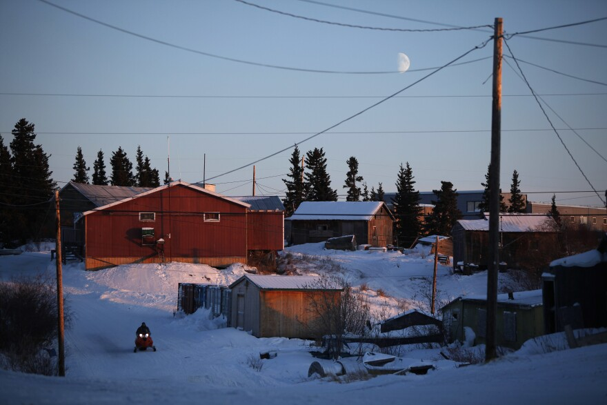 The moon hangs low in the sky over the remote Inupiat Eskimo village of Noorvik, Alaska, the first community in the U.S. counted for the 2010 census.