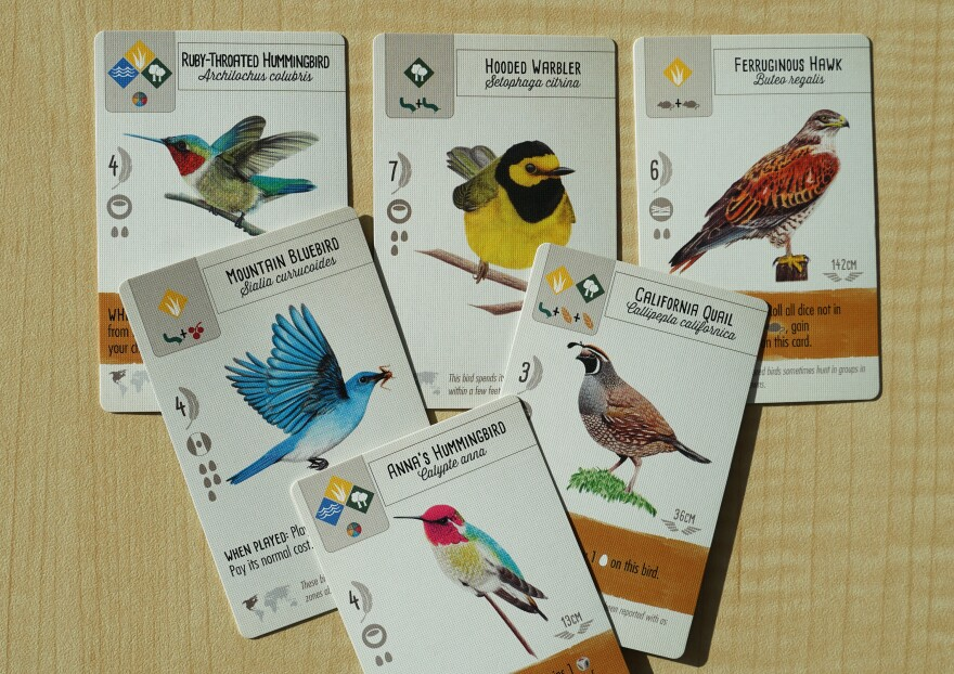 St. Louis-based publisher Stonemaier Games released Wingspan in March. In the game, players attract birds to their wildlife preserve using food, including mice, berries and seeds.