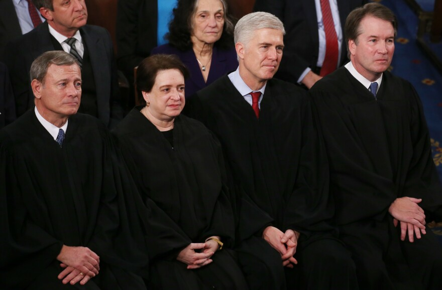 Supreme Court Justices (from left) John Roberts, Elena Kagan, Neil Gorsuch and Brett Kavanaugh attend the State of the Union address on Feb. 4, 2020. In her confirmation hearing, Judge Amy Coney Barrett explained the tradition of judges wearing black robes.