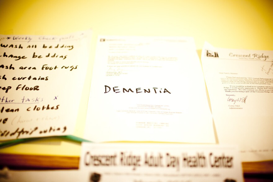 Natasha Shamone-Gilmore keeps a letter from her father's doctor diagnosing him with dementia on a wall in her kitchen. She uses it at times to remind Franklin Brunson of his condition.