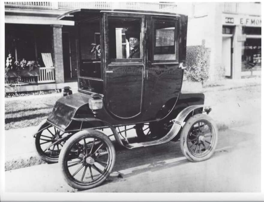 This photos shows Madam Walker at the wheel of her Waverly Electric.
