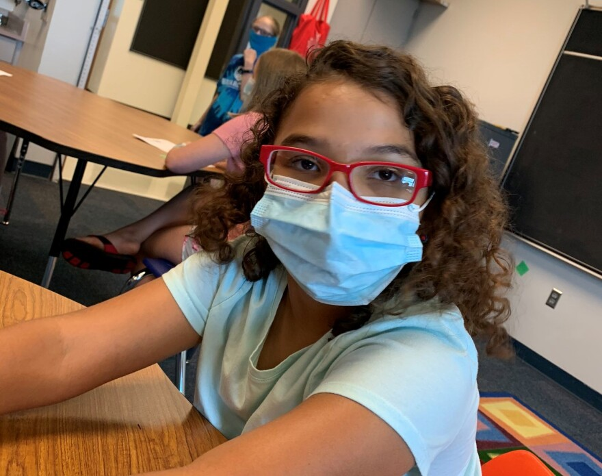A student in the North Kansas City Schools wears a face mask on the first day of summer school. The Centers for Disease Control and Prevention recommend masks for children younger than 2, and pediatricians say wearing masks will help with social distancing in schools.