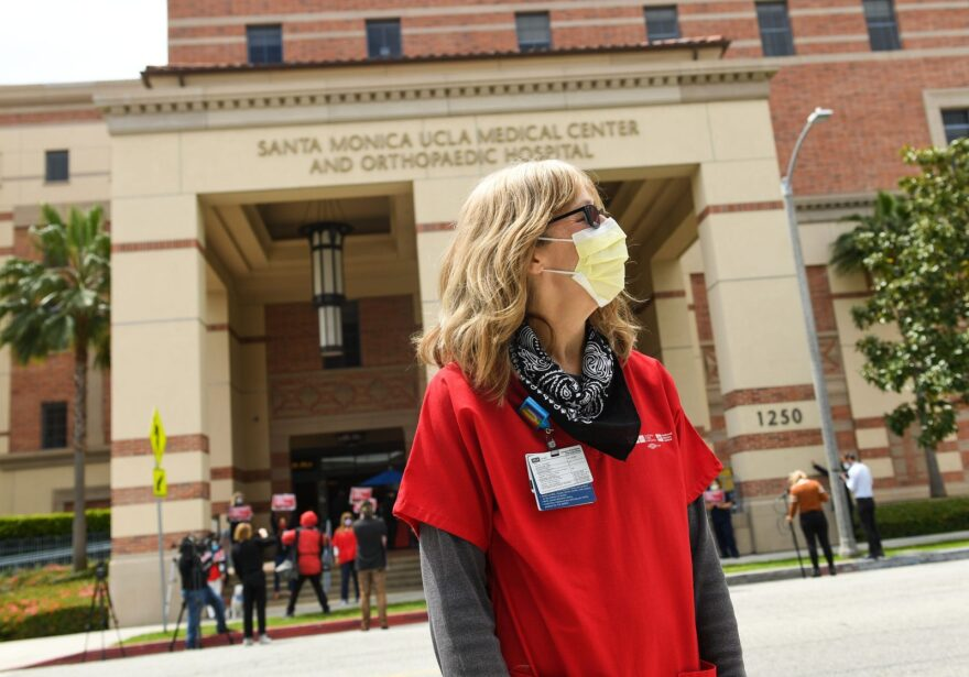A nurse participates in a rally to support the National Nurses United and California Nurses Association's demand for personal protective equipment for healthcare workers across the state at UCLA Medical Center in Santa Monica.