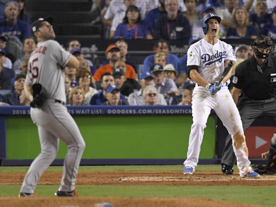 LA's Corey Seager leaps for joy after his sixth-inning two-run home run, giving the Dodgers a 3-1 lead.