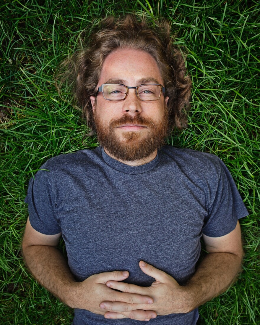 <em>Ask Me Another</em> resident musician, Jonathan Coulton, keeps audiences entertained with his offbeat lyrics and entertaining covers of popular music. JoCo quit his day job writing software in 2005 to pursue a career in music.